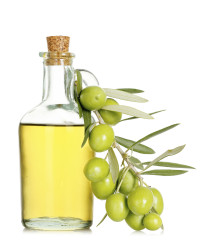 olive oil with olive branch isolated on white