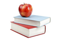 books and red apple isolated on white background